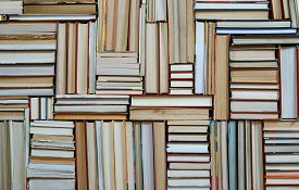 Many Books Piles. Hardback Books On Wooden Table. Books Stack Texture And Background. Back To School