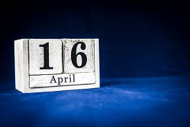 April 16th, Sixteenth Of April, Day 16 Of Month April - Rustic Wooden White Calendar Blocks On Dark