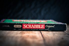 Perth, Scotland - 31 October 2019: Scrabble Board Game | Old Scrabble Box On Vintage Wooden Table