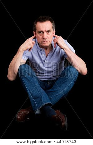 Angry Man Fingers In Ears Not Listening Cross Legged