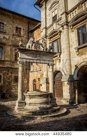 Ancient Well On Piazza Grande Square In Montepulciano, Tuscany, Italy
