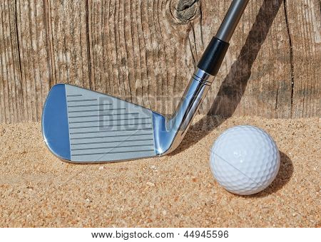 Golf Stick And Ball Support Wooden Close-up On The Sand.