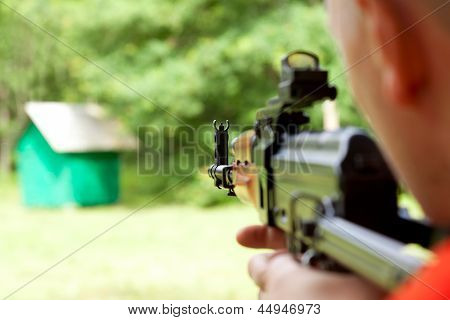 Man Shooting A Shotgun