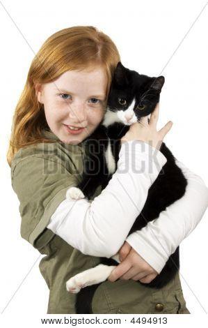 Red Head Girl Holding A Black White Kitten