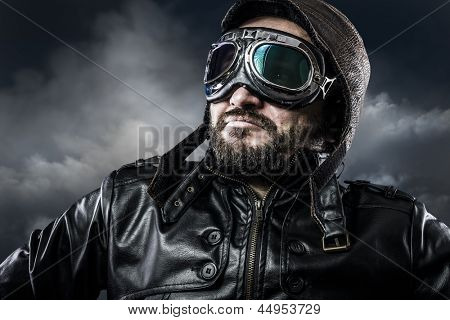 Aviator with glasses and vintage hat with proud expression