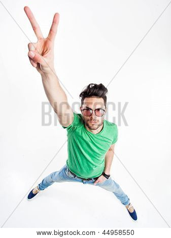 Funny Handsome Man With Hipster Glasses Showing Victory And Smiling  - Wide Angle Shot