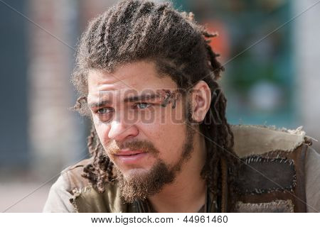 Portrait Young Rebel With Dreadlocks And Tattoos