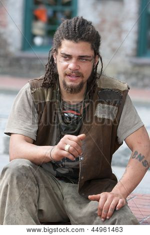Rebel With Dreadlocks And Tattoos