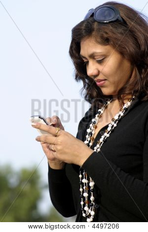 Girl Using Mobile Phone