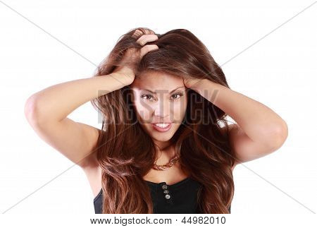 Young Smiling Woman Touches Her Hair Isolated On White Background.
