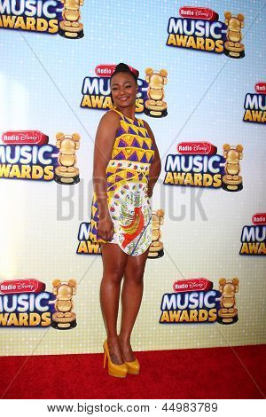 LOS ANGELES - APR 27:  Tatyana Ali arrives at the Radio Disney Music Awards 2013 at the Nokia Theater on April 27, 2013 in Los Angeles, CA