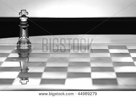 Chess King with reflection as a business concept series with themes of competition, leadership, strategy, strength and CEO - business card design with copy space. poster