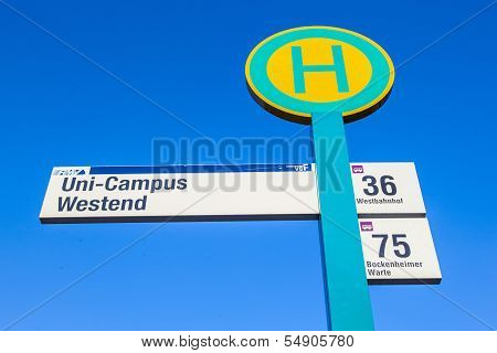 Bus Stop Sign Under Blue Sky