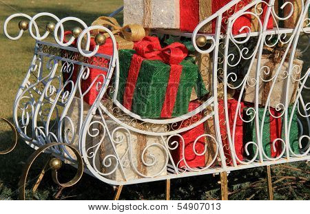 Holiday sleigh filled with presents