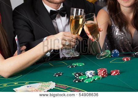 Friends In Casino Raising A Glasses
