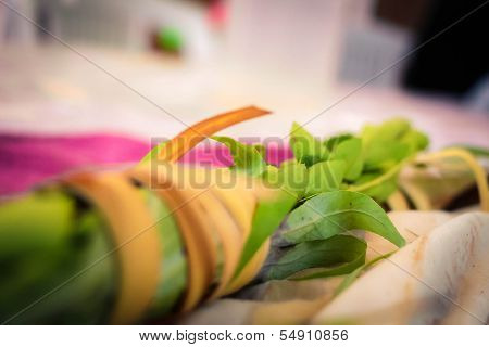 Close up of lulav lying on a table in a sukkah during the Sukkot holiday