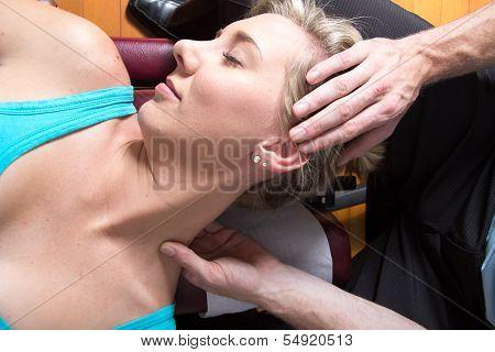 Closeup of female patient neck muscles massage