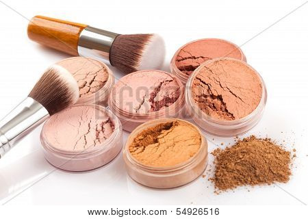 Face powder and brush on white background