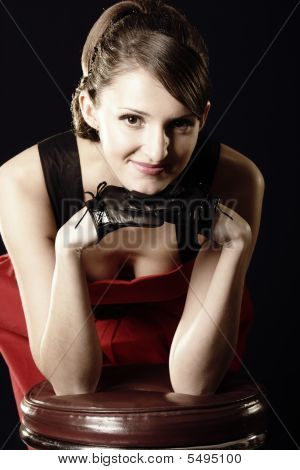 Woman Leaning On Leather Stool