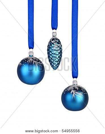 Christmas Decoration. Two Blue Christmas Balls And Cone Hanging On Ribbon, White Background