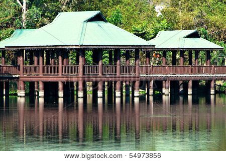 Brown and Green Gazebos on Stilts Above Water