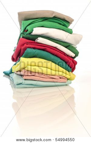 Pile of colorfull shirts isolated
