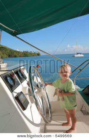 Baby At Helm