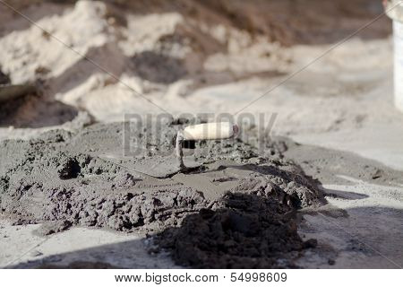 Gray Cement with Cement Trowel in the Nature