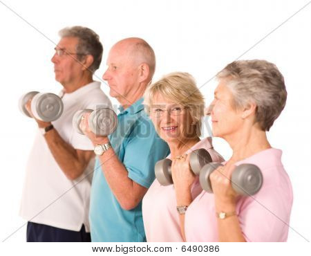 Group of older mature people lifting weights in the gym poster