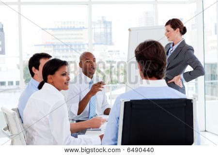 Serious Manager Giving Presentation To Her Team