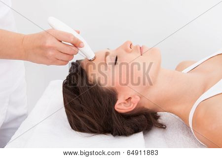 Woman Under Going Microdermabrasion Treatment