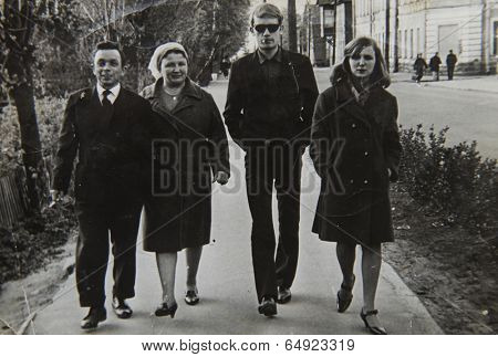 LENINGRAD (now St. Petersburg), RUSSIA - CIRCA 1970-th: Antique photo shows family walking in the street .