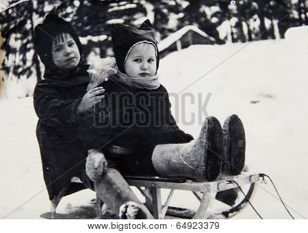 LENINGRAD (now St. Petersburg), RUSSIA - CIRCA 1970-th: Antique photo shows children on sled.