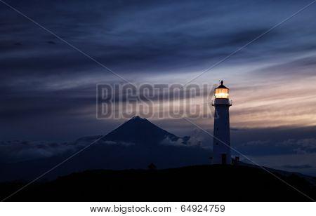 Egmont lighthouse and Taranaki Mount on background, New Zealand