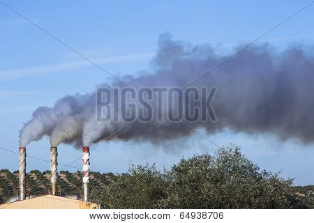 Chimney Expelling Pollutant Gases To The Air, Spain
