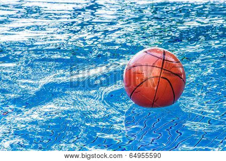 dirty basketball on the water