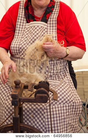 Elderly Woman Spinning Wool