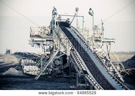 Open pit. Opencast brown coal mine. Belt conveyor as industrial detail. poster