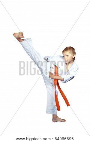 On a white background boy in karategi beat kick Yoko-geri