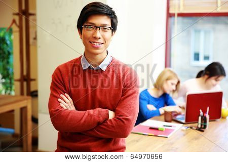 Happy young asian student in classroom