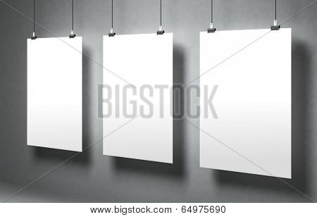 ?hite blank poster on a gray surface. Template for advertising or other images. 3d illustration