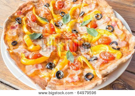Homemade Pizza With Fresh Tomato Olive And Cheese