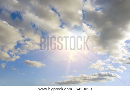 bright sun, looking out over large clouds