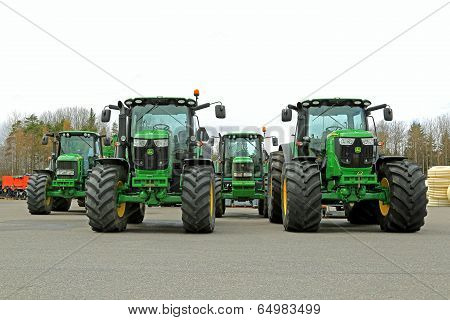 Four John Deere Agricultural Tractors On A Yard