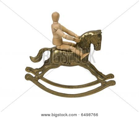 Child sitting and riding on a brass rocking horse - path included poster