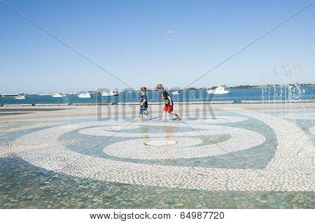Children in water feature.