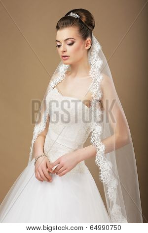 Young Romantic Newlywed With White Veil In Reverie