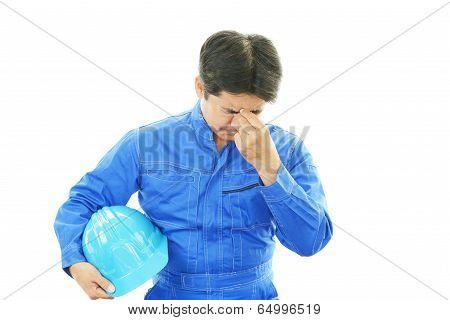 Worker having a headache