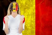 Excited belgium fan in face paint cheering against belgium flag in grunge effect poster