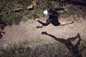 overhead view of trail runner running on mountain poster
